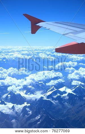 View from the plane over snowy mountains