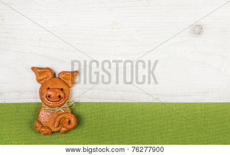Witty and humorously new years greeting card with a handmade pig of salt paste with a green frame.