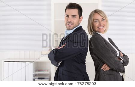 Professional senior and junior business team in portrait at the office with white background.
