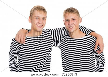 Two twin brother in vests, isolated on a white background. The guys at the age of eighteen.