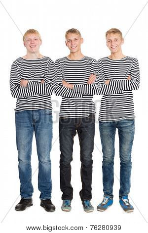 Guys in a striped shirts with arms crossed. Two of the boys twin brothers.