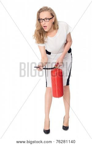 Young scared woman with a fire extinguisher isolated on white