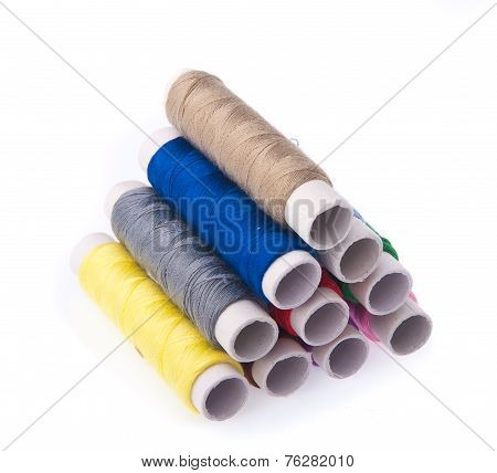 Bobbins Of Thread On Background