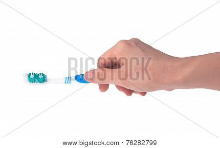 Toothbrush In Hand On Background.