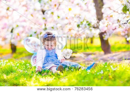 Little Girl In Blooming Garden