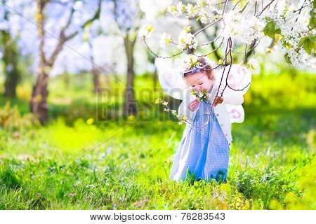 Little Girl In Cherry Garden