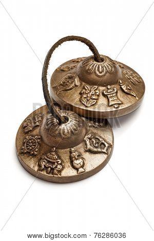 Tibetan Buddhist tingsha cymbals isolated on white