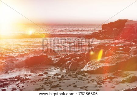 Rocks at the Seashore of Mahe Island, Seychelles, Illuminated by Sunlight During Sunrise Time.
