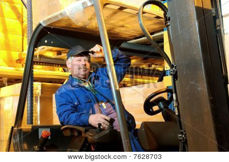 Forklift Loader Worker At Warehouse