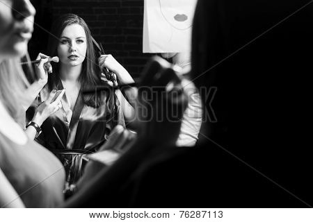 Plus size fashion models prepared for runway by stylish designer. Black and white photography
