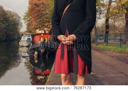 Woman Standing By Houseboat