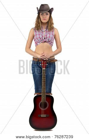 Image of standing cowgirl with the guitar