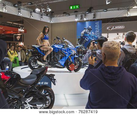 Beautiful Model Posing On Suzuki Motorbike At Eicma 2014 In Milan, Italy