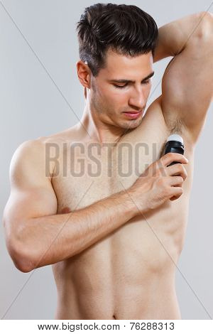 Man using antiperspirant