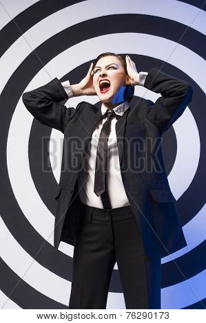 Pretty woman with evening make up and red lips in a bow-tie in a center of a dartboard background