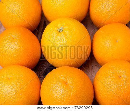 many fresh oranges on wooden background
