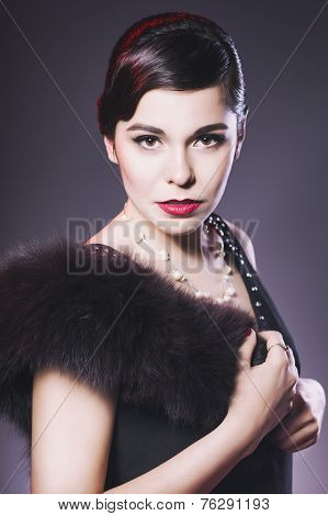 Beautiful Brunette Retro Woman with red lips make up and wave bang hairstyle and closed eyes