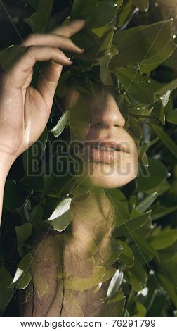 Double exposure portrait of sensual woman combined with photograph of leaves