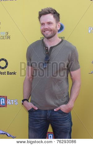 LOS ANGELES - NOV 16:  Joel McHale at the PS Arts Express Yourself Benefit at the Barker Hanger on November 16, 2014 in Santa Monica, CA