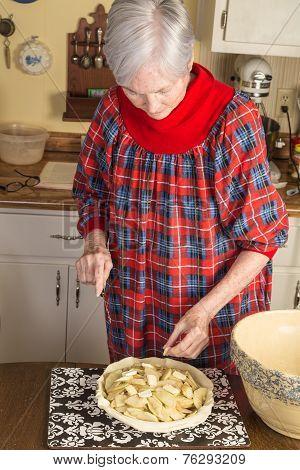 Senior Lady In Kitchen
