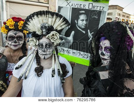 Three Women In Dia De Los Muertos Makeup