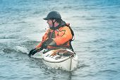 stock photo of rough-water  - Kayak surfer on rough sea by misty day on Nova Scotia coastlines Canada - JPG