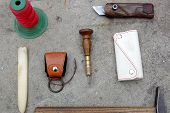 foto of leather tool  - Tool for making leather accessories and some of product - JPG