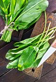 stock photo of sorrel  - fresh sorrel on the wooden board and on a table - JPG