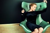 image of art nouveau  - Portrait of a stunning fashionable model sitting in a chair in Art Nouveau style - JPG