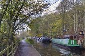 picture of barge  - Barge on the canal in autumn England UK - JPG