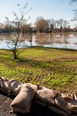 foto of sandbag  - barricades of sandbags along the banks of the river - JPG