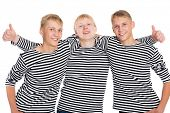 stock photo of conscript  - Group of guys in striped shirts - JPG