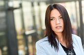 picture of straight jacket  - Portrait of businesswoman in modern office building - JPG