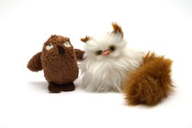 image of nursery rhyme  - An owl and a cat soft toy pose together - JPG