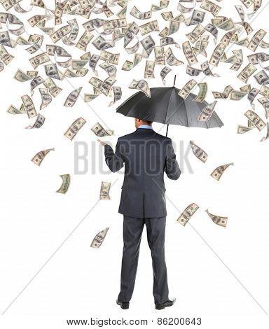 Businessman standing in the rain of money