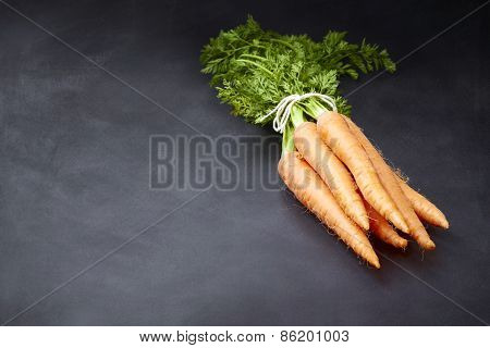 Fresh Carrots Bunch On Blackboard