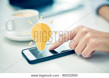 business, technology, communication, idea and people concept - close up of woman hand pointing finger to smartphone screen with lighting bulb icon in office