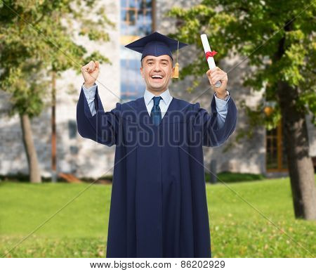 education, graduation and people concept - smiling adult student in mortarboard with diploma rising hands up and laughing over campus background