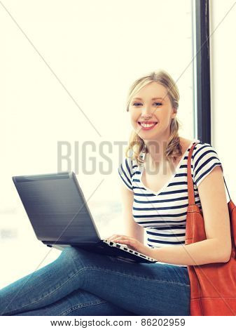 picture of happy teenage girl with laptop computer