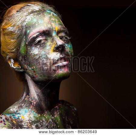 Elegant woman portrait with face art on face