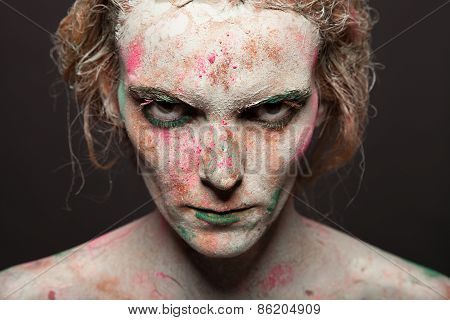 portrait of beautiful woman with silver bodyart