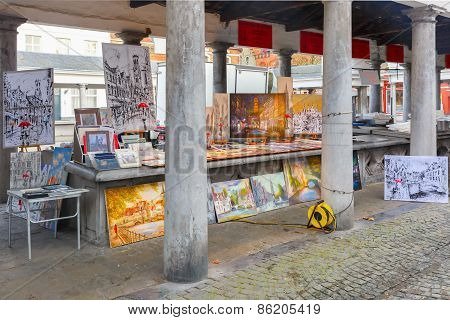 Paintings for sale on the fish market Vismarkt in Bruges, Belgium