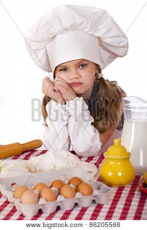 Beautiful little baby dressed as a cook, isolated on a white background