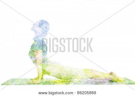Nature harmony healthy lifestyle concept - double exposure image of  woman doing yoga asana Upward Facing Dog Pose (Back Bend) (Urdhva Mukha Svanasana) asana exercise isolated on white background