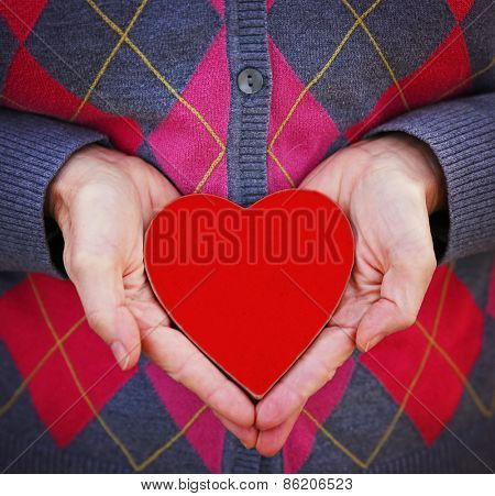 hands holding a red valentine's day heart