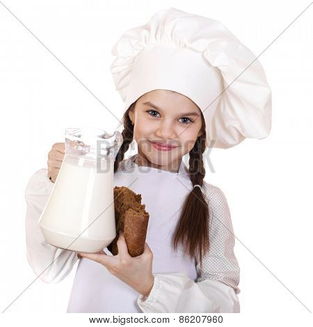 Cooking and people concept - Little girl in a white apron holding a jug of milk, isolated on white background