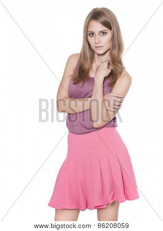 Happy blond girl in a skirt and blouse