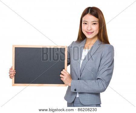 Asian business girl holding blank blackboard