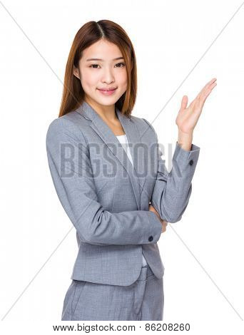 Smiling businesswoman showing copy space for product