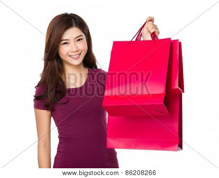 Happy shopping young woman raise arms with bags